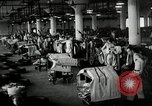 Image of jobs at factories in America during Great Depression United States USA, 1932, second 55 stock footage video 65675030527