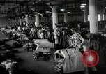Image of jobs at factories in America during Great Depression United States USA, 1932, second 56 stock footage video 65675030527