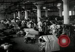 Image of jobs at factories in America during Great Depression United States USA, 1932, second 57 stock footage video 65675030527