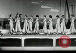 Image of aquatic dance Paris France, 1934, second 3 stock footage video 65675030590