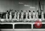 Image of aquatic dance Paris France, 1934, second 5 stock footage video 65675030590