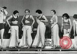 Image of aquatic dance Paris France, 1934, second 10 stock footage video 65675030590