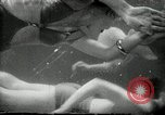Image of aquatic dance Paris France, 1934, second 19 stock footage video 65675030590