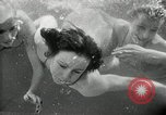 Image of aquatic dance Paris France, 1934, second 23 stock footage video 65675030590