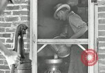 Image of milk barrels Saint Clairsville Ohio USA, 1940, second 18 stock footage video 65675030600