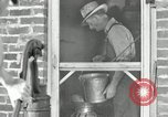 Image of milk barrels Saint Clairsville Ohio USA, 1940, second 19 stock footage video 65675030600