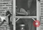 Image of milk barrels Saint Clairsville Ohio USA, 1940, second 23 stock footage video 65675030600