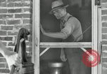 Image of milk barrels Saint Clairsville Ohio USA, 1940, second 24 stock footage video 65675030600