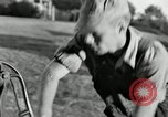 Image of milk barrels Saint Clairsville Ohio USA, 1940, second 42 stock footage video 65675030600