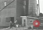 Image of milk barrels Saint Clairsville Ohio USA, 1940, second 46 stock footage video 65675030600