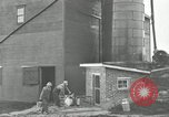 Image of milk barrels Saint Clairsville Ohio USA, 1940, second 47 stock footage video 65675030600