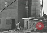 Image of milk barrels Saint Clairsville Ohio USA, 1940, second 48 stock footage video 65675030600