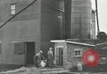 Image of milk barrels Saint Clairsville Ohio USA, 1940, second 49 stock footage video 65675030600