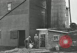 Image of milk barrels Saint Clairsville Ohio USA, 1940, second 50 stock footage video 65675030600