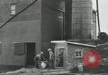 Image of milk barrels Saint Clairsville Ohio USA, 1940, second 51 stock footage video 65675030600