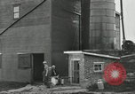 Image of milk barrels Saint Clairsville Ohio USA, 1940, second 52 stock footage video 65675030600