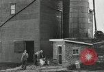 Image of milk barrels Saint Clairsville Ohio USA, 1940, second 53 stock footage video 65675030600