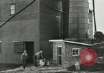 Image of milk barrels Saint Clairsville Ohio USA, 1940, second 54 stock footage video 65675030600