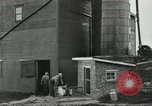 Image of milk barrels Saint Clairsville Ohio USA, 1940, second 55 stock footage video 65675030600