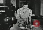 Image of farm family in evening Saint Clairsville Ohio USA, 1940, second 28 stock footage video 65675030605