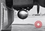 Image of B-24 experiment refueling a P-38 drop tank in flight Wilmington Delaware USA, 1944, second 31 stock footage video 65675030619