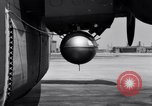 Image of B-24 experiment refueling a P-38 drop tank in flight Wilmington Delaware USA, 1944, second 36 stock footage video 65675030619