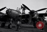 Image of Native tribesmen with P-38 planes New Guinea, 1944, second 5 stock footage video 65675030622