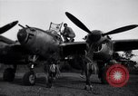 Image of Native tribesmen with P-38 planes New Guinea, 1944, second 7 stock footage video 65675030622