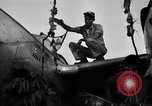 Image of Native tribesmen with P-38 planes New Guinea, 1944, second 10 stock footage video 65675030622