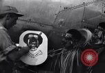 Image of Native tribesmen with P-38 planes New Guinea, 1944, second 25 stock footage video 65675030622