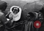 Image of Native tribesmen with P-38 planes New Guinea, 1944, second 27 stock footage video 65675030622