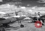Image of P-38 planes and ground crews of 80th Fighter Squadron Port Moresby New Guinea, 1944, second 1 stock footage video 65675030623
