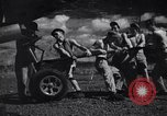 Image of P-38 planes and ground crews of 80th Fighter Squadron Port Moresby New Guinea, 1944, second 24 stock footage video 65675030623