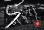 Image of P-38 planes and ground crews of 80th Fighter Squadron Port Moresby New Guinea, 1944, second 25 stock footage video 65675030623