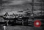 Image of Mechanics of  80th Fighter Squadron work on a P-38 New Guinea, 1944, second 1 stock footage video 65675030624