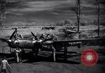 Image of Mechanics of  80th Fighter Squadron work on a P-38 New Guinea, 1944, second 2 stock footage video 65675030624