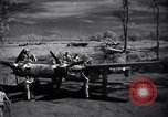 Image of Mechanics of  80th Fighter Squadron work on a P-38 New Guinea, 1944, second 3 stock footage video 65675030624