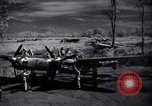Image of Mechanics of  80th Fighter Squadron work on a P-38 New Guinea, 1944, second 4 stock footage video 65675030624