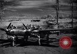 Image of Mechanics of  80th Fighter Squadron work on a P-38 New Guinea, 1944, second 7 stock footage video 65675030624