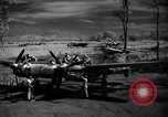 Image of Mechanics of  80th Fighter Squadron work on a P-38 New Guinea, 1944, second 8 stock footage video 65675030624