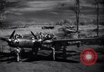 Image of Mechanics of  80th Fighter Squadron work on a P-38 New Guinea, 1944, second 9 stock footage video 65675030624