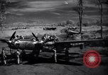 Image of Mechanics of  80th Fighter Squadron work on a P-38 New Guinea, 1944, second 10 stock footage video 65675030624