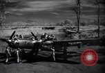Image of Mechanics of  80th Fighter Squadron work on a P-38 New Guinea, 1944, second 11 stock footage video 65675030624