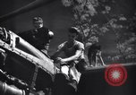 Image of Mechanics of  80th Fighter Squadron work on a P-38 New Guinea, 1944, second 13 stock footage video 65675030624
