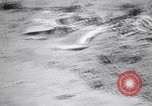 Image of Japanese airfield and planes at Lae destroyed by allied bombers New Guinea, 1943, second 16 stock footage video 65675030887