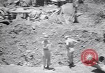 Image of Japanese airfield and planes at Lae destroyed by allied bombers New Guinea, 1943, second 18 stock footage video 65675030887