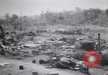Image of Japanese airfield and planes at Lae destroyed by allied bombers New Guinea, 1943, second 24 stock footage video 65675030887