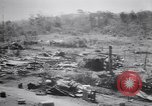 Image of Japanese airfield and planes at Lae destroyed by allied bombers New Guinea, 1943, second 25 stock footage video 65675030887