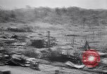 Image of Japanese airfield and planes at Lae destroyed by allied bombers New Guinea, 1943, second 26 stock footage video 65675030887