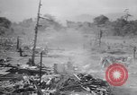 Image of Japanese airfield and planes at Lae destroyed by allied bombers New Guinea, 1943, second 30 stock footage video 65675030887